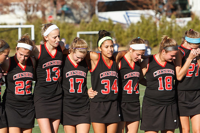 Cheshire players wrap their arms around each other after loosing the class L final to Darien Saturday at Cottone Field in Wethersfield  Nov., 16 2013 | Justin Weekes / For the Record-Journal