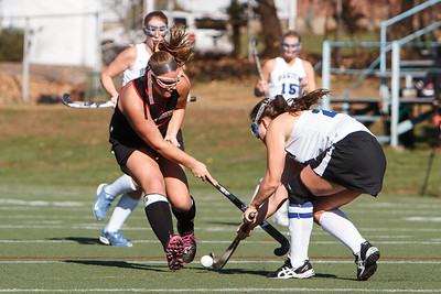 Cheshire's Emma Farrel (18) challenges Darien's Mollie Riegel (24) Saturday at Cottone Field in Wethersfield  Nov., 16 2013 | Justin Weekes / For the Record-Journal