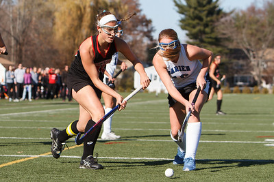 Cheshire's Michelle Federico (44) looks to center a pass around Darien's Kelsey Bumgardner (10) during the class L final Saturday at Cottone Field in Wethersfield  Nov., 16 2013 | Justin Weekes / For the Record-Journal