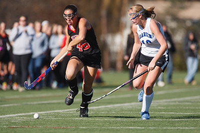 Cheshire's Mikayla Crieger (46) drives up the sideline past Darien's Kelsey Bumgardner (10) Saturday at Cottone Field in Wethersfield  Nov., 16 2013 | Justin Weekes / For the Record-Journal
