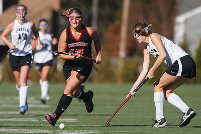 Cheshire's Emma Farrel (18) pushes the ball past Darien's Katie Shanahan (18)  Saturday at Cottone Field in Wethersfield  Nov., 16 2013 | Justin Weekes / For the Record-Journal