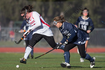 Cheshire's Meaghan Hogan gets past Staples Christine Taylor Friday at Alumni Field during the CIAC Class L quarterfinal round on the campus of Cheshire High School in Cheshire. Staples defeated Cheshire 2 to 1.November 10, 2017 | Justin Weekes / For the Record-Journal