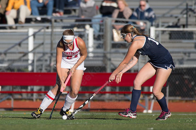 Cheshire's Anne Eddy gets past   Lauralton Hall's Leah Cogguillo Monday at Alumni Field on the campus of Cheshire High School in Cheshire October 30, 2017 | Justin Weekes / For the Record-Journal