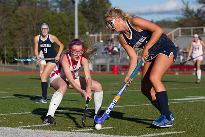 Cheshire's Mikayla Crowley challenges Lauralton Hall's Lauren Dowling  Monday at Alumni Field on the campus of Cheshire High School in Cheshire October 30, 2017 | Justin Weekes / For the Record-Journal