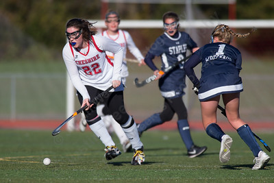 Cheshire's Meaghan Hogan gets past Staples Ellen Fair Friday at Alumni Field during the CIAC Class L quarterfinal round on the campus of Cheshire High School in Cheshire. Staples defeated Cheshire 2 to 1.November 10, 2017 | Justin Weekes / For the Record-Journal