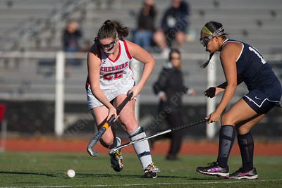 Cheshire's Meaghan Hogan gets past a defender Monday at Alumni Field on the campus of Cheshire High School in Cheshire October 30, 2017 | Justin Weekes / For the Record-Journal