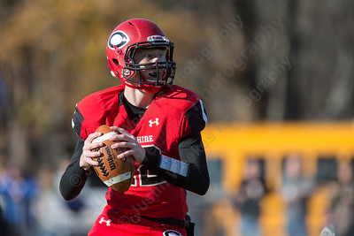 Cheshire's quarterback Will Graikoski (12) drops back for a pass on the opening drive of the game Thursday at Alumni Field for the Apple Classic Thanksgiving Day game in Cheshire Nov. 26, 2015 | Justin Weekes / For the Record-Journal