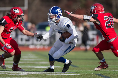 Southington's Austin Morin (8) returns an interception Thursday at Alumni Field for the Apple Classic Thanksgiving Day game in Cheshire Nov. 26, 2015 | Justin Weekes / For the Record-Journal