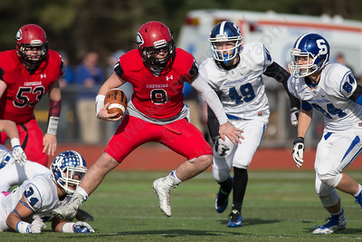Cheshire's Brian Weyrauch (9) breaks a few tackles attempts Thursday at Alumni Field for the Apple Classic Thanksgiving Day game in Cheshire Nov. 26, 2015 | Justin Weekes / For the Record-Journal