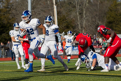Southington's Alessio Diana (42) score for the Blue Knights Thursday at Alumni Field for the Apple Classic Thanksgiving Day game in Cheshire Nov. 26, 2015 | Justin Weekes / For the Record-Journal