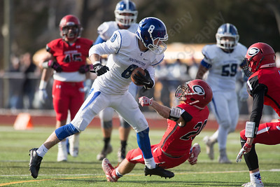 Southington's Austin Morin (8) looks for extra yards after a reception Thursday at Alumni Field for the Apple Classic Thanksgiving Day game in Cheshire Nov. 26, 2015 | Justin Weekes / For the Record-Journal