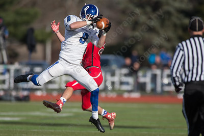 Southington's Austin Morin (8) intercepts a pass intended for Cheshire's Andrew Criscuolo (20) Thursday at Alumni Field for the Apple Classic Thanksgiving Day game in Cheshire Nov. 26, 2015 | Justin Weekes / For the Record-Journal