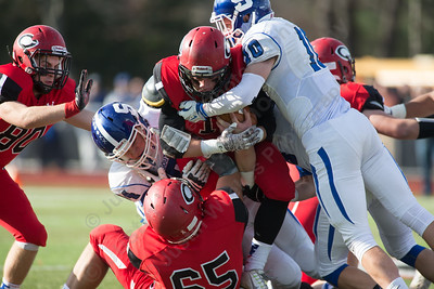 Cheshire's RJ Oris (10) busts through the Southington defense for extra yards Thursday at Alumni Field for the Apple Classic Thanksgiving Day game in Cheshire Nov. 26, 2015   Justin Weekes / For the Record-Journal