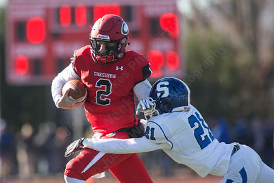 Cheshire's Jack Raba scrambles as Southington's Mario Ferreri brings him down for a lose Thursday during the 22nd Annual Apple Classic on Thanksgiving Day at Alumni Field on the campus of Cheshire High School in Cheshire. The Blue Knights of Southington defeated the Cheshire Rams 30 to 22. November 23, 2017 | Justin Weekes / For the Record-Journal