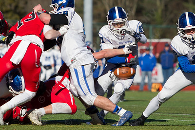 Cheshire's Dan Calbo knocks the ball out of Southington's Tanner LaRosa Thursday during the 22nd Annual Apple Classic on Thanksgiving Day at Alumni Field on the campus of Cheshire High School in Cheshire. The Blue Knights of Southington defeated the Cheshire Rams 30 to 22. November 23, 2017 | Justin Weekes / For the Record-Journal