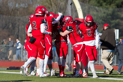 Cheshire celebrates Cole Escoto's touchdown Thursday during the 22nd Annual Apple Classic on Thanksgiving Day at Alumni Field on the campus of Cheshire High School in Cheshire. The Blue Knights of Southington defeated the Cheshire Rams 30 to 22. November 23, 2017 | Justin Weekes / For the Record-Journal