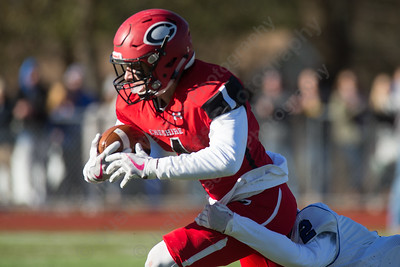 Cheshire's Michael Jeffery comes up with the deep ball for a big gain Thursday during the 22nd Annual Apple Classic on Thanksgiving Day at Alumni Field on the campus of Cheshire High School in Cheshire. The Blue Knights of Southington defeated the Cheshire Rams 30 to 22. November 23, 2017 | Justin Weekes / For the Record-Journal