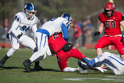 Southington's Joseph Koczera brings down Cheshire's Jack Raba for a lose Thursday during the 22nd Annual Apple Classic on Thanksgiving Day at Alumni Field on the campus of Cheshire High School in Cheshire. The Blue Knights of Southington defeated the Cheshire Rams 30 to 22. November 23, 2017 | Justin Weekes / For the Record-Journal