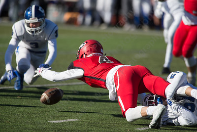 Cheshire's Michael Jeffery losses the handle but regains possession after a reception Thursday during the 22nd Annual Apple Classic on Thanksgiving Day at Alumni Field on the campus of Cheshire High School in Cheshire. The Blue Knights of Southington defeated the Cheshire Rams 30 to 22. November 23, 2017 | Justin Weekes / For the Record-Journal
