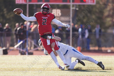 Cheshire's Jack Raba is brought down by Southington's Ian Hall Thursday during the 22nd Annual Apple Classic on Thanksgiving Day at Alumni Field on the campus of Cheshire High School in Cheshire. The Blue Knights of Southington defeated the Cheshire Rams 30 to 22. November 23, 2017 | Justin Weekes / For the Record-Journal