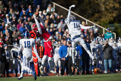 Cheshire's Eric Angelone comes up with the deep ball a flag brought the play back for offensive interference Thursday during the 22nd Annual Apple Classic on Thanksgiving Day at Alumni Field on the campus of Cheshire High School in Cheshire. The Blue Knights of Southington defeated the Cheshire Rams 30 to 22. November 23, 2017 | Justin Weekes / For the Record-Journal