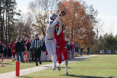 Cheshire's Nicholas Quint breaks up a pass to Southington's Timothy O'Shea  Thursday during the 22nd Annual Apple Classic on Thanksgiving Day at Alumni Field on the campus of Cheshire High School in Cheshire. The Blue Knights of Southington defeated the Cheshire Rams 30 to 22. November 23, 2017 | Justin Weekes / For the Record-Journal
