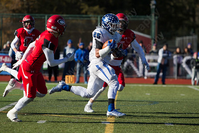 Southington's Ryan Montalvo runs for a gain Thursday during the 22nd Annual Apple Classic on Thanksgiving Day at Alumni Field on the campus of Cheshire High School in Cheshire. The Blue Knights of Southington defeated the Cheshire Rams 30 to 22. November 23, 2017 | Justin Weekes / For the Record-Journal