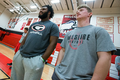 Cheshire's Jake McAlinden right and Elijah Allston wait for floor space during an inside practice Friday a Cheshire High School in Cheshire  November 16, 2018 | Justin Weekes / Special to the Record-Journal