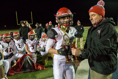 Cheshire's Alec Frione receives the defensive MVP award from Athletic Director Steve Trifone Wednesday during the 23rd Annual Apple Valley Classic at Fontana Field on the campus of Southington high School in Southington November 21, 2018 | Justin Weekes / Special to the Record-Journal