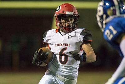 Cheshire's Christian Russo runs for a first down Wednesday during the 23rd Annual Apple Valley Classic at Fontana Field on the campus of Southington high School in Southington November 21, 2018 | Justin Weekes / Special to the Record-Journal