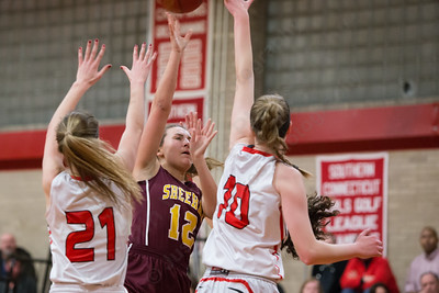 Sheehan's Cassie Strickland gets a shot off as Cheshire's Mia Pulisciano (21) and Ciara Haensel defend Wednesday at Cheshire High School in Cheshire Feb. 3, 2016 | Justin Weekes / For the Record-Journal