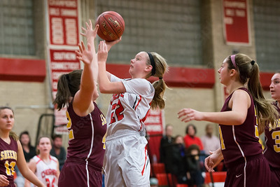 Cheshire's Mia Juodaitis gets a shot off as Sheehan's Rebecca Hilton  defends Wednesday at Cheshire High School in Cheshire Feb. 3, 2016 | Justin Weekes / For the Record-Journal