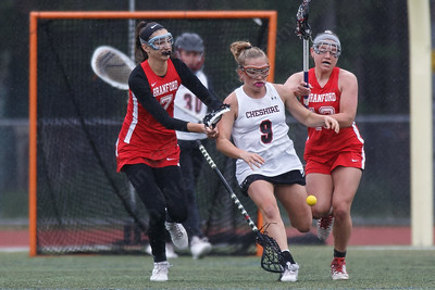 Cheshire's Mikayla Crowley gets her stick checked by Branford's Haley Maercklein (7) Tuesday at Alumni Field during the SCC semifinals on the campus of Cheshire High School in Cheshire May 22, 2018 | Justin Weekes / Special to the Record-Journal