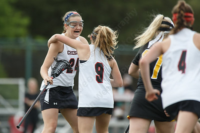 Cheshire's Anne Eddy celebrates after scoring Thursday at Cheshire High School in Cheshire May 17, 2018 | Justin Weekes / Special to the Record-Journal
