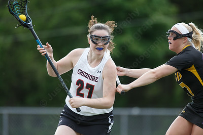 Cheshire's Meaghan Hogan gets past a Hand defender Thursday at Cheshire High School in Cheshire May 17, 2018 | Justin Weekes / Special to the Record-Journal