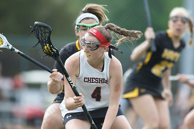Cheshire's Caroline Dutchyshyn spins to beat a defender Thursday at Cheshire High School in Cheshire May 17, 2018 | Justin Weekes / Special to the Record-Journal