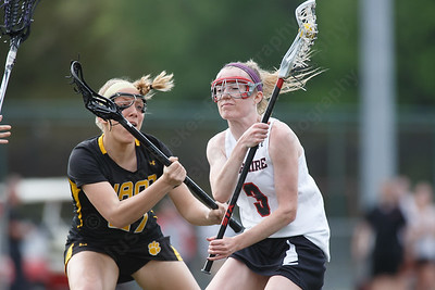 Cheshire's Mikayla Crowley works past defenders Thursday at Cheshire High School in Cheshire May 17, 2018 | Justin Weekes / Special to the Record-Journal