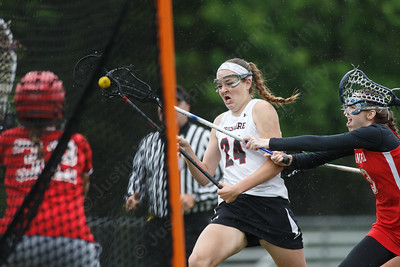Cheshire's Anne Eddy gets fouled by Branford's Caroline Erickson Tuesday at Alumni Field during the SCC semifinals on the campus of Cheshire High School in Cheshire May 22, 2018   Justin Weekes / Special to the Record-Journal
