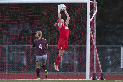 Cheshire's keeper Sam Mathews plays a crossing pass from North Haven Tuesday at Alumni Field on the campus of Cheshire High School in Cheshire October 10, 2017 | Justin Weekes / For the Record-Journal
