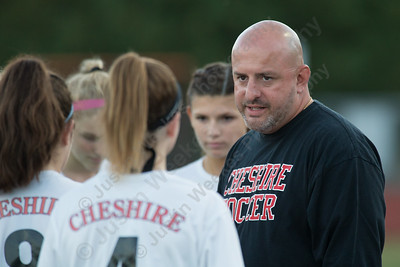 Cheshire's head coach James Luis talks with players Tuesday at Alumni Field on the campus of Cheshire High School in Cheshire October 10, 2017 | Justin Weekes / For the Record-Journal