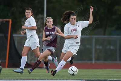 Cheshire's Paige Perez cuts past a defender Tuesday at Alumni Field on the campus of Cheshire High School in Cheshire October 10, 2017 | Justin Weekes / For the Record-Journal