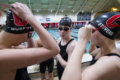 Cheshire's Elizabeth Boyer center Sophie Murphy left and Julia Stevens gets ready for the 200 medley relay Wednesday during the CIAC Class L swimming finals at the Freeman Athletic Center Natatorium on the campus of Wesleyan University in Middletown November 15, 2017 | Justin Weekes / For the Record-Journal