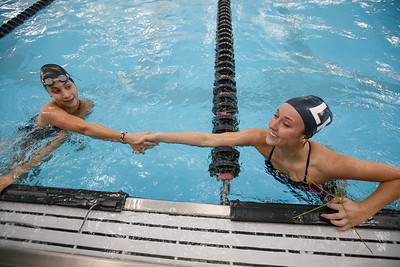 Lyman Hall's Sarah Beverage congratulates Cheshire's Sophie Murphy  Thursday at the Cheshire Community Pool in Cheshire September 20, 2018 | Justin Weekes / Special to the Record-Journal