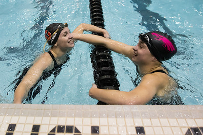 Cheshire's Samantha Grenon gets congratulated by Wethersfield's Abigail Francis Tuesday during the CIAC Class L swimming finals at the Hutchinson Natatorium on the campus of SCSU in New Haven November 13, 2018 | Justin Weekes / Special to the Record-Journal