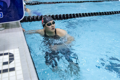 Cheshire's Ester Han check her time in the 100 freestyle Tuesday during the CIAC Class L swimming finals at the Hutchinson Natatorium on the campus of SCSU in New Haven November 13, 2018 | Justin Weekes / Special to the Record-Journal