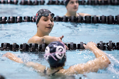 Cheshire's Sophie Murphy reaches to shake hands with Wilton's Taylor Loud Tuesday during the CIAC Class L swimming finals at the Hutchinson Natatorium on the campus of SCSU in New Haven November 13, 2018 | Justin Weekes / Special to the Record-Journal