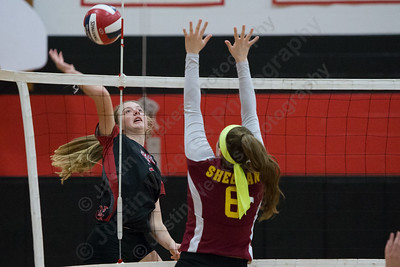 Cheshire's Mia Juodaitis cuts a spike for a kill Thursday during the SCC semifinals at Cheshire High School in Cheshire November 2, 2017   Justin Weekes / For the Record-Journal