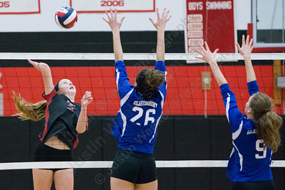 Cheshire's Mia Juodaitis drives a spike through Glastonbury blockers Saturday during the CIAC Class LL quarterfinals at Cheshire High School in Cheshire November 11, 2017   Justin Weekes / For the Record-Journal