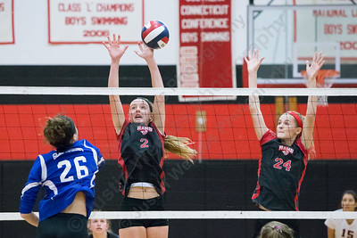 Cheshire's Mia Juodaitis blocks Glastonbury's Sydney Tennyson Saturday during the CIAC Class LL quarterfinals at Cheshire High School in Cheshire November 11, 2017   Justin Weekes / For the Record-Journal