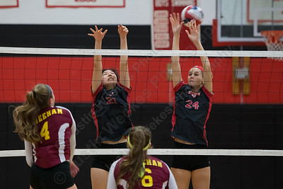 Cheshire's Jenny Wang and Brady McQuade try to block Sheehan's Samantha Iannone Thursday during the SCC semifinals at Cheshire High School in Cheshire November 2, 2017   Justin Weekes / For the Record-Journal